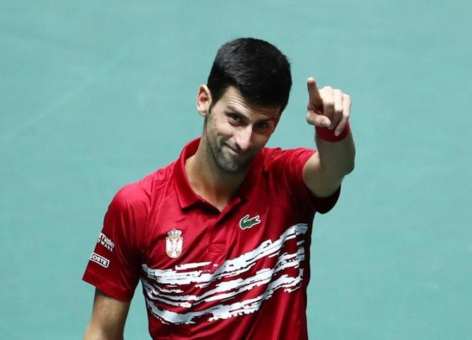 Serbia's Novak Djokovic celebrates winning his match against France's Benoit Paire.
