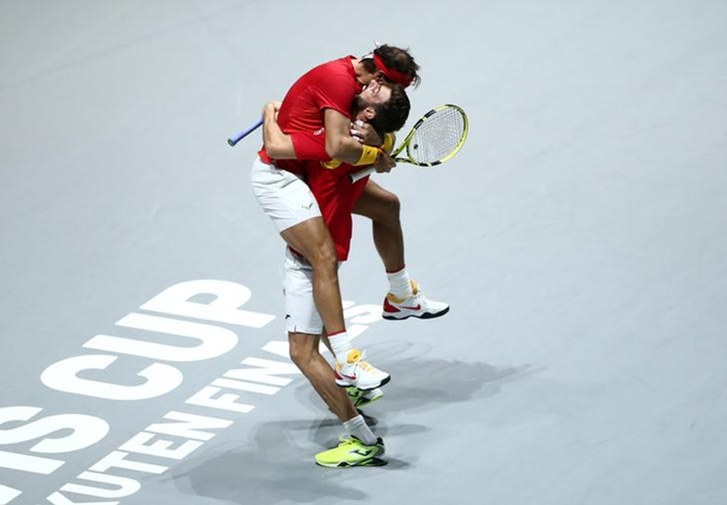 Rafael Nadal and Marcel Granollers-Pujol celebrate victory.
