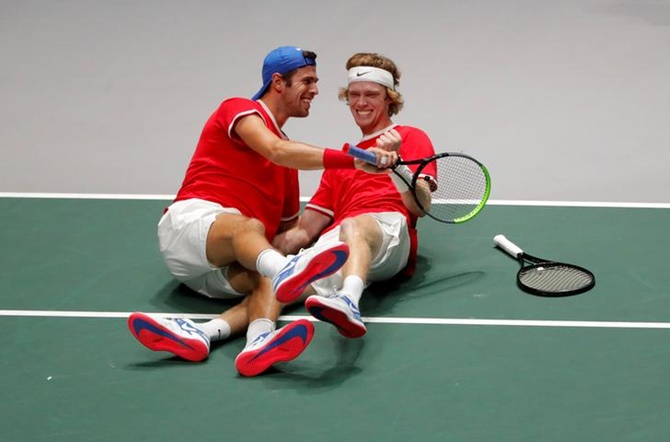 Russia's Andrey Rublev and Karen Khachanov celebrate after winning their doubles match against Serbia's Novak Djokovic and Viktor Troicki.