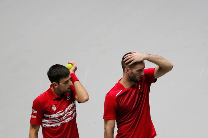 Serbia's Novak Djokovic and Viktor Troicki react after losing to Russia's Andrey Rublev and Karen Khachanov.