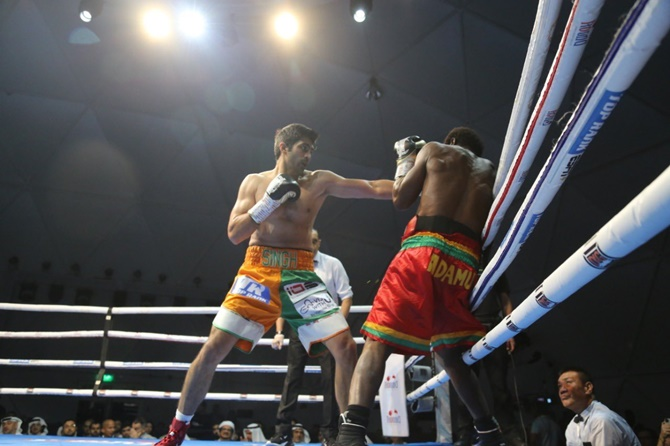 Vijender Singh has Ghana's Charles Adamu on the ropes during Friday night's fight in Dubai.