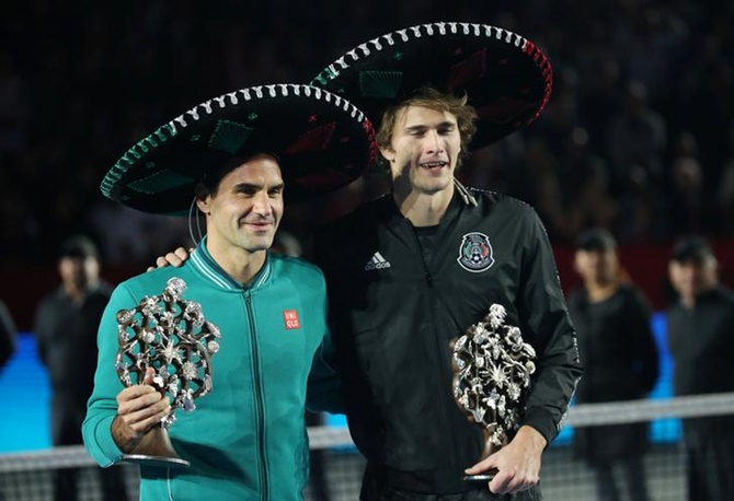 Switzerland's Roger Federer and Germany's Alexander Zverev pose for a photo after the match