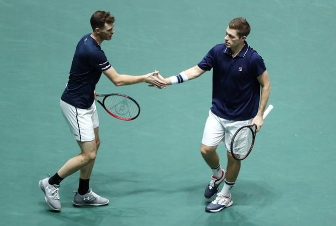 Britian's Jamie Murray and Neal Skupski react during their doubles match against Spain's Rafael Nadal and Feliciano Lopez