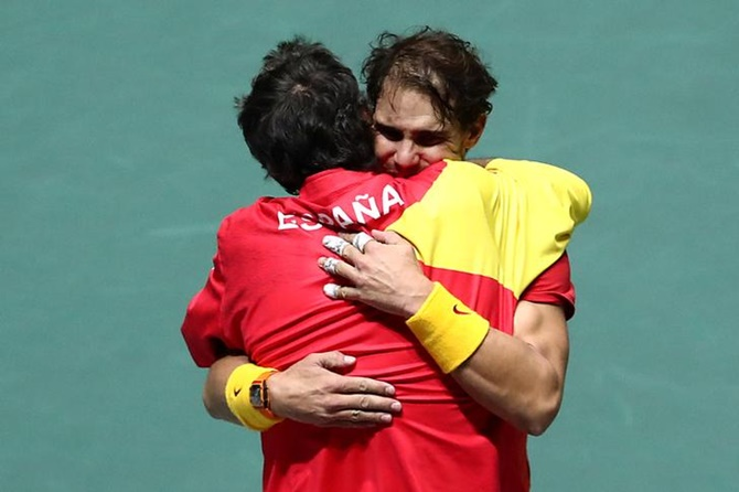 Spain captain Sergi Bruguera celebrates with Rafael Nadal