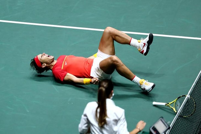 Spain's Rafael Nadal celebrates after he and Feliciano Lopez defeat Britian's Jamie Murray and Neal Skupski in the doubles match of the Davis Cup semi-final