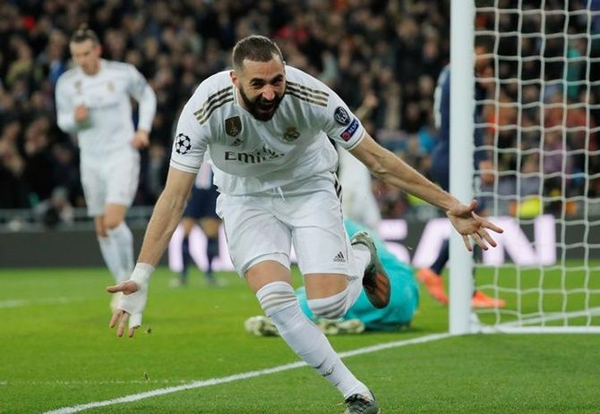 Karim Benzema celebrates scoring Real Madrid's second goal in Tuesday's Champions League Group A match against Paris St Germain