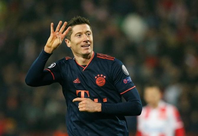 Robert Lewandowski celebrates scoring Bayern Munich's fifth goal, his fourth of the match against Red Star Belgrade