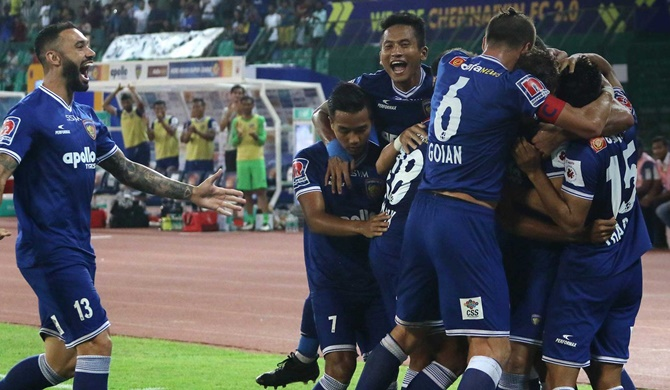 Chennaiyin FC players celebrate after scoring against Odisha FC