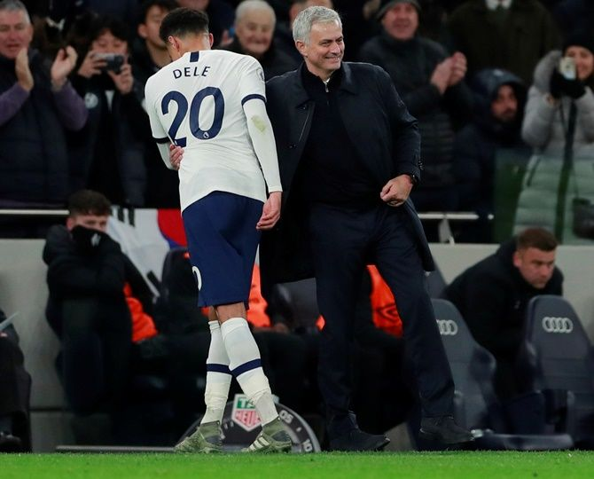 Tottenham Hotspur's Dele Alli gets a pat from manager Jose Mourinho