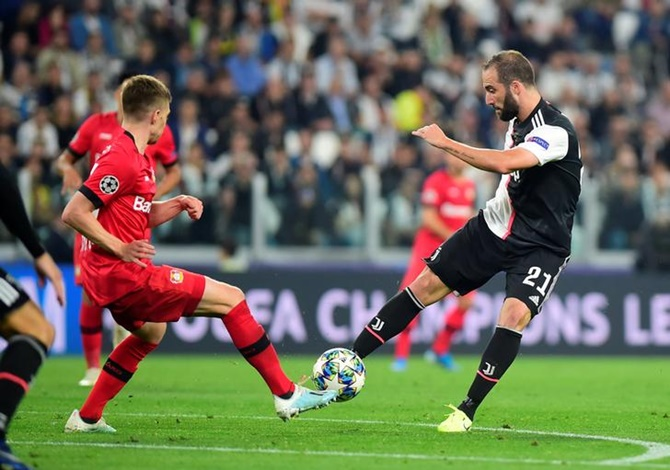 Juventus's Gonzalo Higuain shoots at goal during the match against Bayer Leverkusen.