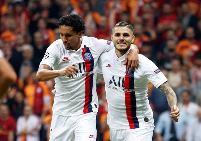 Mauro Icardi celebrates with teammate Marquinhos after scoring for Paris St Germain against Galatasaray.