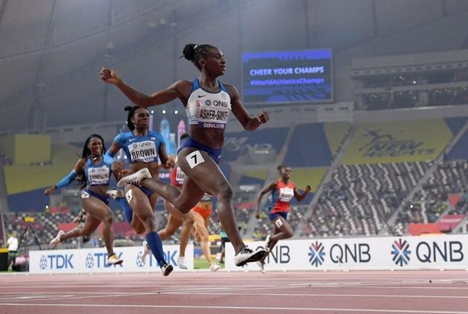 Great Britain's Dina Asher-Smith defeats Brittany Brown and Anglerne Annelus aka Angie Annelus of the United States to win the women's 200 metresat the IAAF World Athletics Championships in Doha on Wednesday.