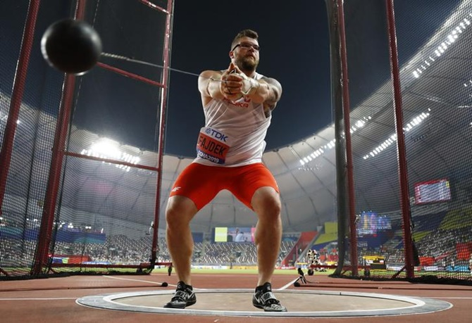 Poland's Pawel Fajdek goes through his routine during the men's hammer throw at the World Championships on Wednesday.