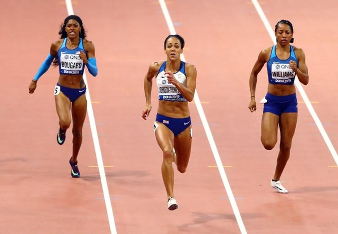 Britain's Katarina Johnson-Thompson finishes ahead of Kendell Williams and Erica Bougard of the United States in the women's heptathlon 200 metres.