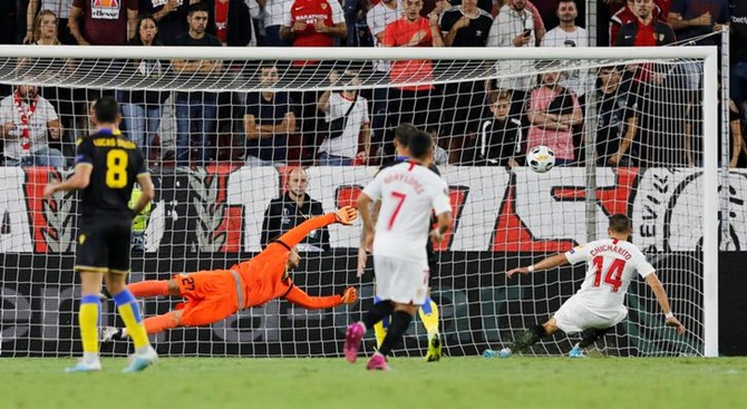 Javier Hernandez scores Sevilla's first goal against Apoel Nicosia in the Group A match.
