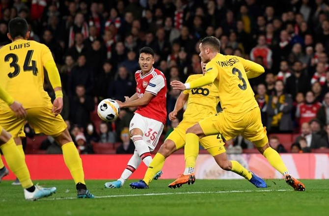 Gabriel Martinelli scores Arsenal's second goal against Standard Liege in the Europa League Group F match at Emirates Stadium, London.