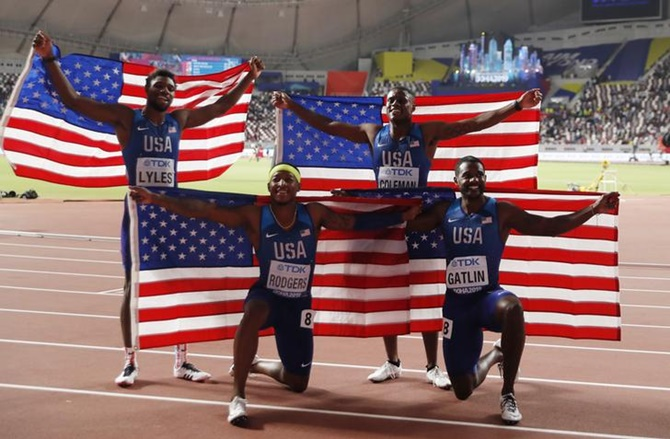 Christian Coleman, Justin Gatlin, Michael Rodgers and Noah Lyles of the United States after winning gold in the men's 4x100 relay.
