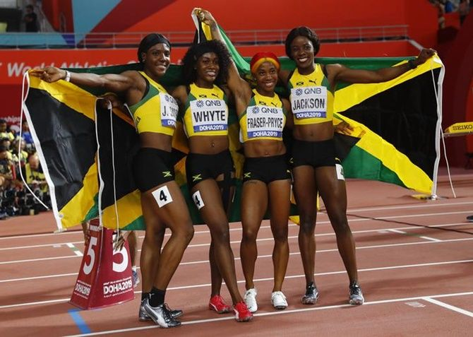 Jamaica's Shelly-Ann Fraser-Pryce, Natalliah Whyte, Jonielle Smith and Shericka Jackson celebrate winning the women's 4x100 metres gold.