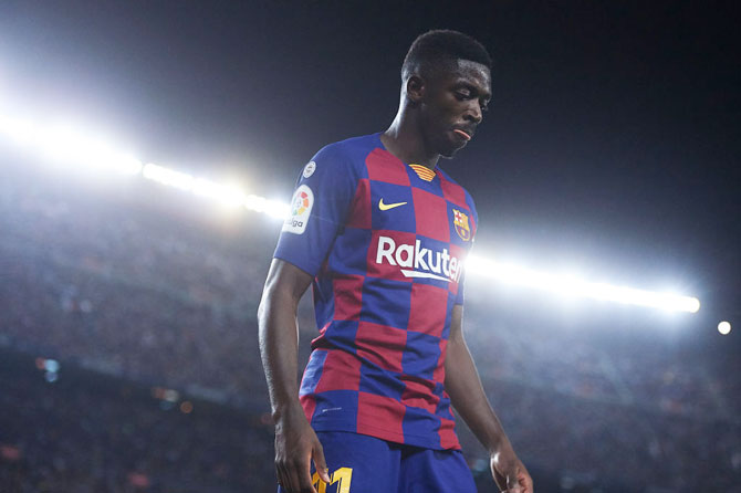 FC Barcelona'S Ousmane Dembele Walks off after being shown the red card