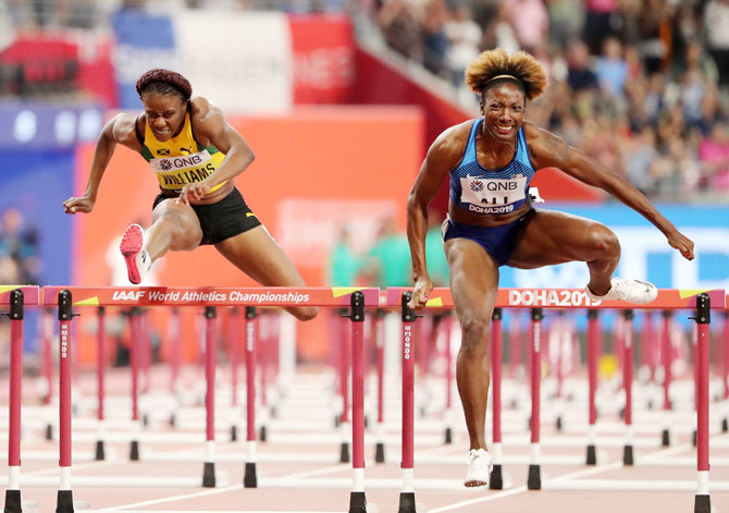 USA's Nia Ali competes against Jamaica's Danielle Williams en route to winning the Women's 100 Metres Hurdles gold
