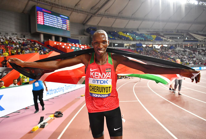 Kenya's Timothy Cheruiyot poses as he celebrates winning gold in the Men's 1500 Metres Final