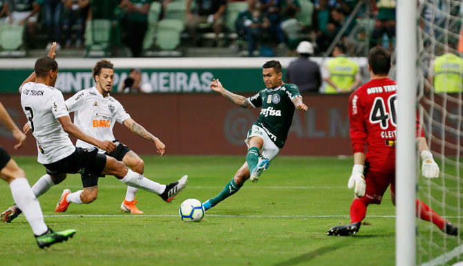Palmeiras' Dudu scores the opening goal against Atletico Mineiro during their Brasileirao Series A match at Allianz Parque in Sao Paulo, Brazil, on Sunday