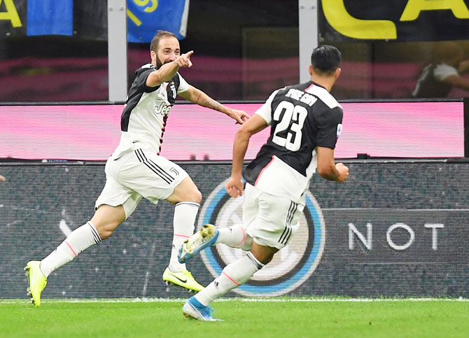 Juventus' Gonzalo Higuain celebrates scoring their second and winning goal against Inter Milan in their Seria A match at San Siro in Milan on Sunday