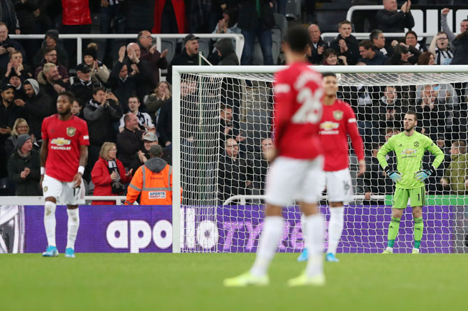 Manchester United's David de Gea and team mates look dejected Newcastle United's Matthew Longstaff scored the first goal during their EPL match on Sunday. Goalkeeper David de Gea said it was the worst moment for the club since he joined in 2011