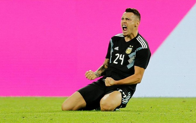 Lucas Ocampos celebrates scoring Argentina's second goal in Wednesday's international friendly against Germany in Dortmund.