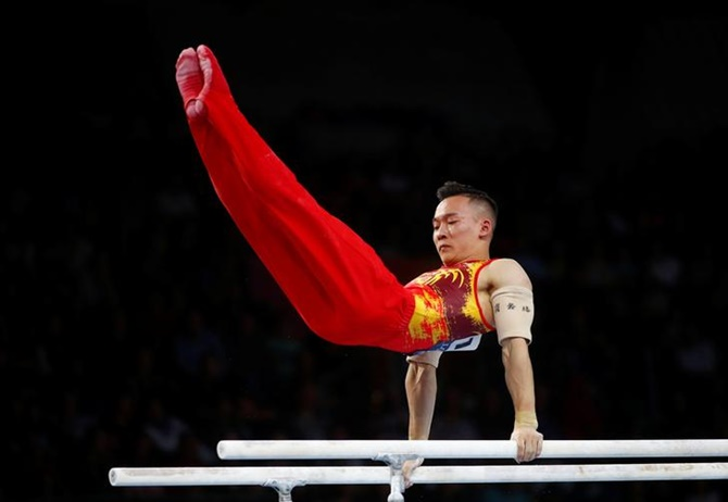 China's Xiao Ruoteng on the Parallel Bars during the men's team final.
