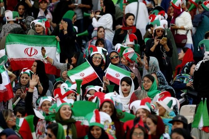 Iranian women fans attend Iran's FIFA World Cup Asian qualifier against Cambodia