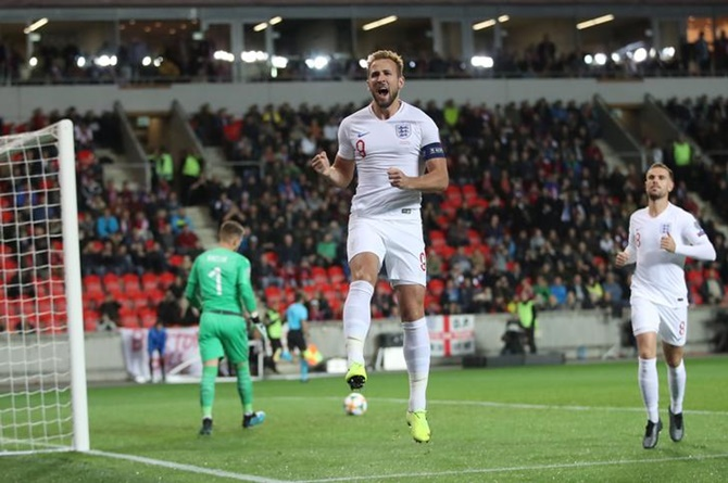 Harry Kane celebrates putting England ahead from the penalty spot.