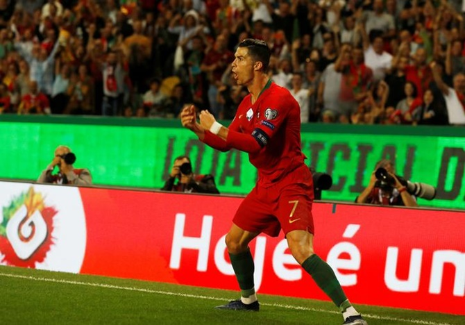Cristiano Ronaldo celebrates scoring Portugal's second goal against Luxembourg.