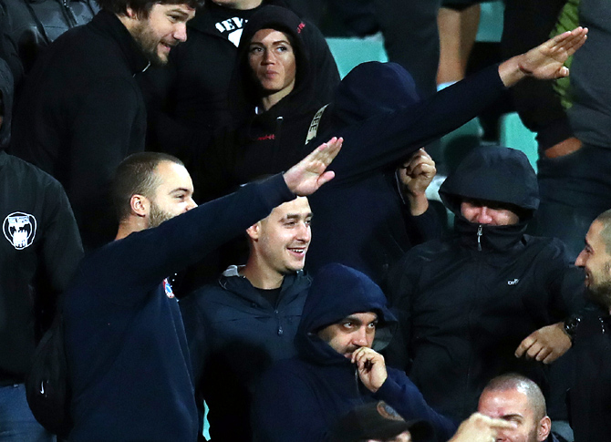 A group of black-clad Bulgarian fans, some of whom were making right-wing salutes, were moved from an area behind the dugout during the Euro qualifier between Bulgaria and England in Sofia on Monday