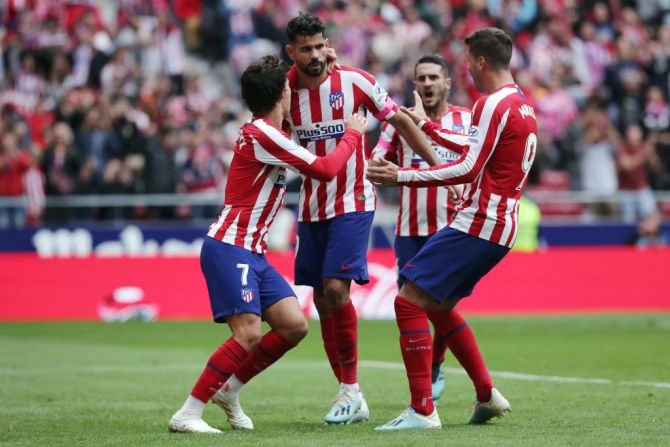 Atletico Madrid's celebrates with teammates after scoring his team's first goal against Club Atletico de Madrid in their La Liga match at Wanda Metropolitano in Madrid on Saturday