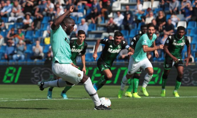 FC Internazionale's Romelu Lukaku scores to convert a penalty to score the team's second goal against US Sassuolo
