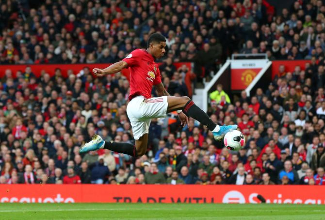 Manchester United's Marcus Rashford scores the opening goal
