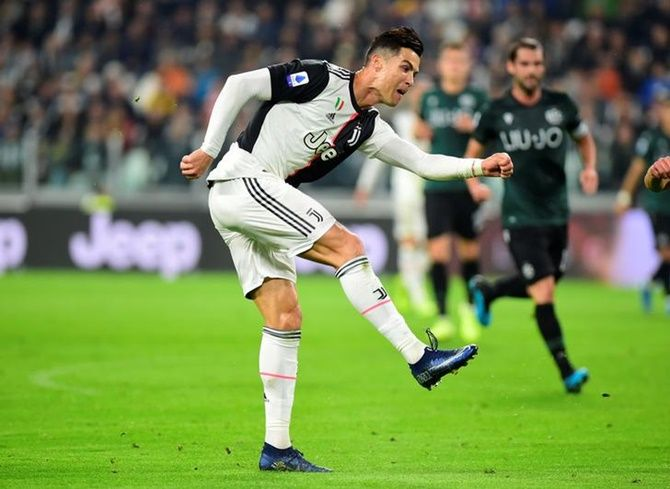 Cristiano Ronaldo scores Juventus's first goal against Bologna during Saturday's Serie A match at Allianz Stadium, in Turin, Italy.