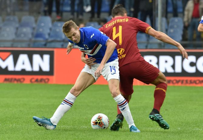 UC Sampdoria's Jakub Jankto battles for the ball with AS Roma's Bryan Cristante during their Serie A match at Stadio Luigi Ferraris in Genoa, Italy, on Sunday