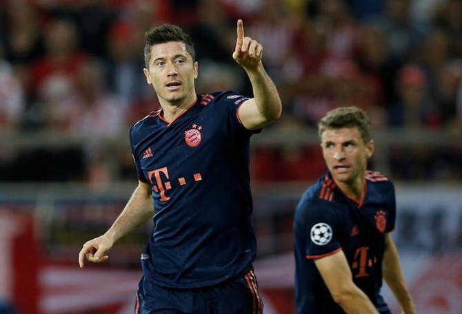 Robert Lewandowski waves to the crowd after scoring Bayern Munich's first goal in the  Group B match against Olympiacos