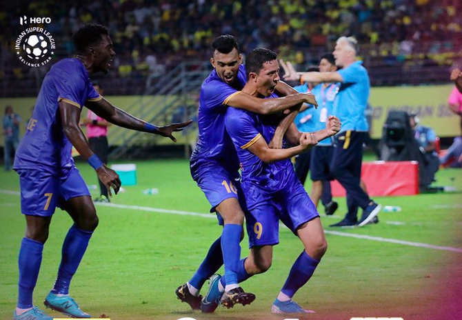 Mumbai City players celebrate after Amine Chermiti scores.