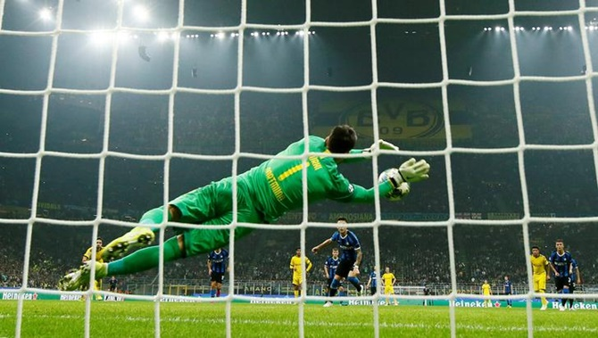 Borussia Dortmund's Roman Burki saves a penalty from Inter Milan's Lautaro Martinez