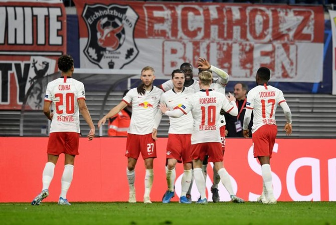 Marcel Sabitzer, centre, celebrates scoring Leipzig's second goal