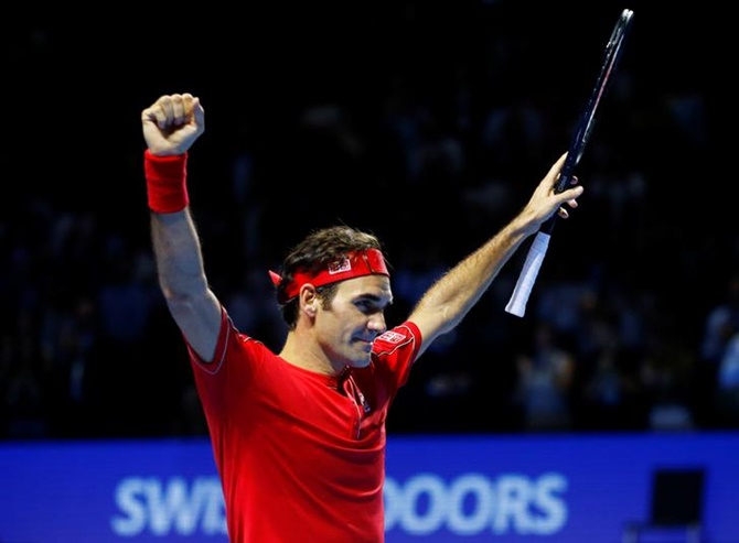 Switzerland's Roger Federer celebrates beating Australia's Alex de Minaur in the final of the Swiss Indoors Basel.