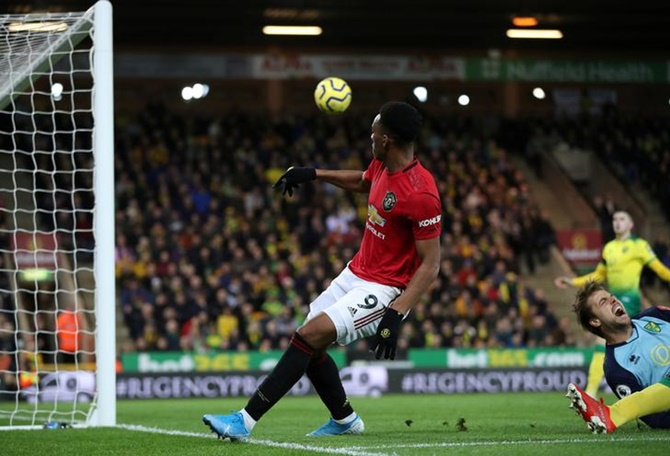 Anthony Martial scores Manchester United's third goal.
