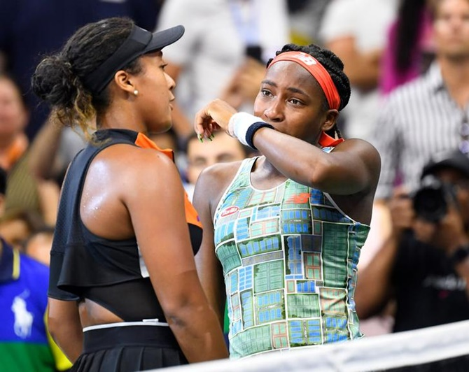 Naomi Osaka, left, consoles Coco Gauff after their third round match.