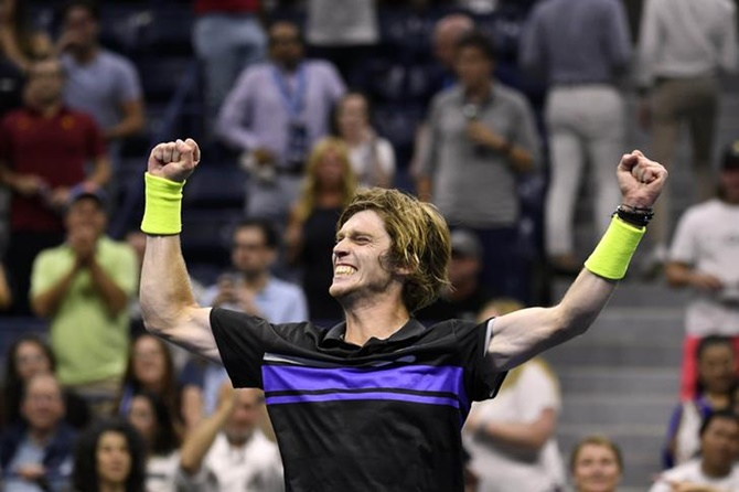 Andrey Rublev celebrates victory over Nick Kyrgios in the third round.