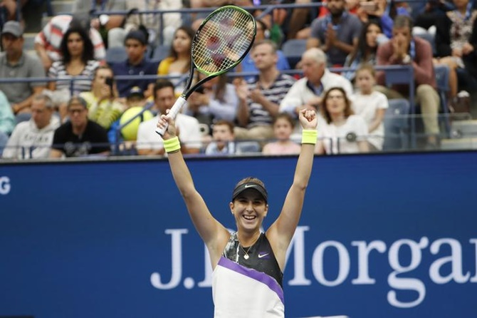 Belinda Bencic celebrates victory over Naomi Osaka at the US Open
