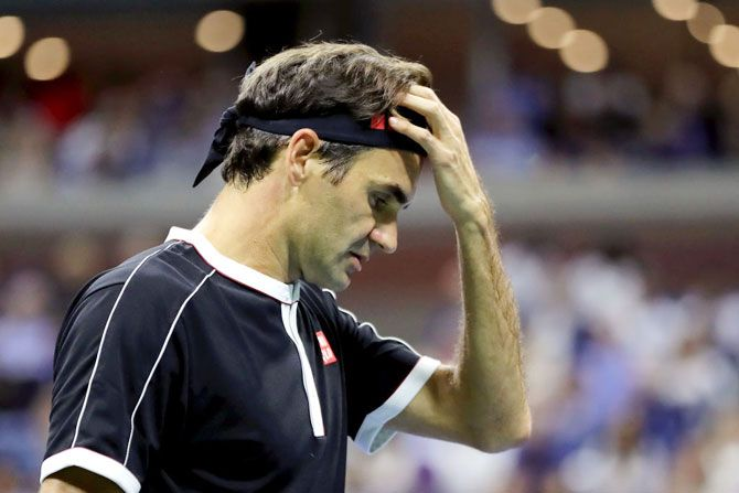 Roger Federer was beaten by Grigor Dimitrov in the US Open quarter-final at Flushing Meadows in New York on Tuesday