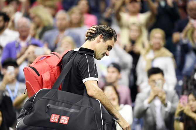 Switzerland's Roger Federer walks off the court after losing to Bulgaria's Grigor Dimitrov in a quarter-final match on day nine of the 2019 US Open tennis tournament on Tuesday